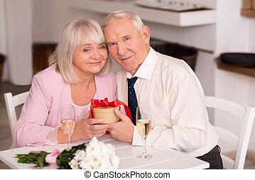 Happy senior couple celebrating anniversary - Feeling like a...