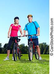 Happy senior couple cyclist.