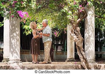 Happy senior couple dancing latin american dance for fun -...