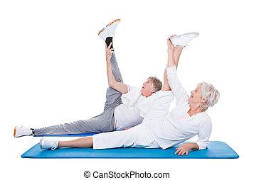 Senior Couple Doing Exercise - Happy Senior Couple Doing...