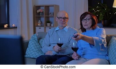 happy senior couple drink red wine and watch tv - holidays, ...