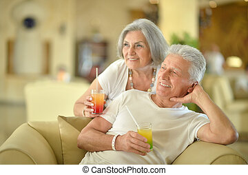 senior couple drinking cocktails