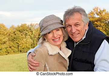 Happy senior couple embracing each other in countryside