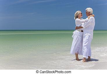 Happy Senior Couple Embracing on Tropical Beach