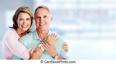 Happy senior couple. - Happy senior loving couple over blue...