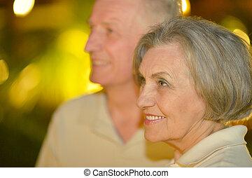 Happy senior couple - Happy smiling senior couple at evening...