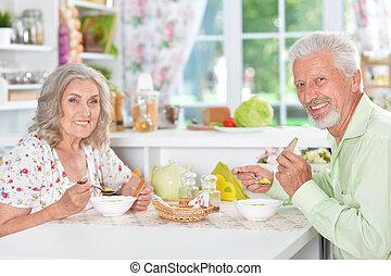 Senior couple having meal