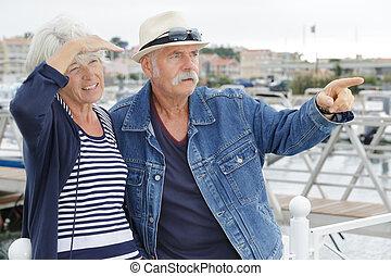 happy senior couple in a port
