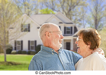 Happy Senior Couple in Front Yard of House - Happy Senior...