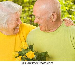 Happy senior couple in love outdoors