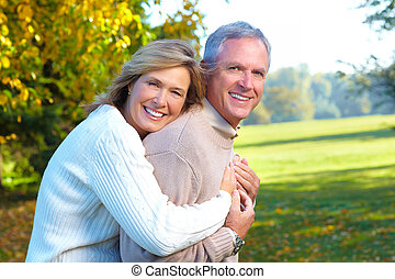 Happy senior couple in park.