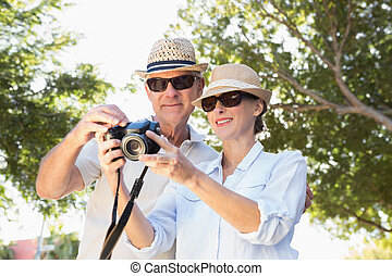 Happy senior couple looking at their camera