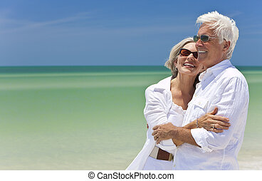 Happy Senior Couple Looking To Sea on A Tropical Beach - ...