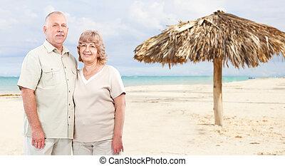 Happy senior couple on caribbean beach.