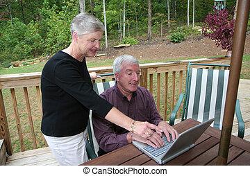 Happy Senior Couple on Computer