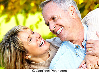 Happy senior couple. - Happy senior couple in love. Park...