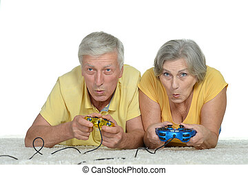 Senior Couple Plays Video Game