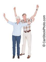 Senior Couple Raising Hand
