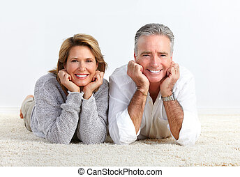 Senior couple relaxing at home.