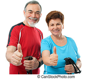 thumbs up - happy senior couple showing thumbs up isolated...