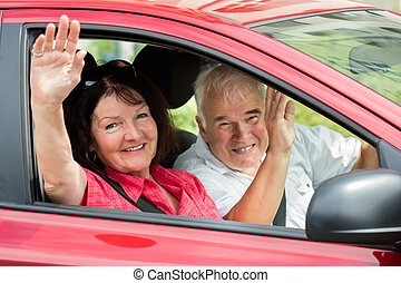Happy Senior Couple Sitting Inside Car
