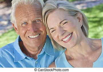 Happy Senior Couple Smiling Outside in Sunshine