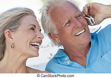 Happy Senior Couple Talking on Mobile Cell Phone