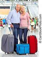 Happy senior couple tourists.