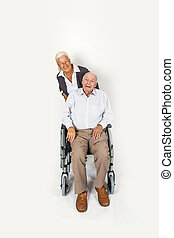 happy senior couple with man in wheelchair