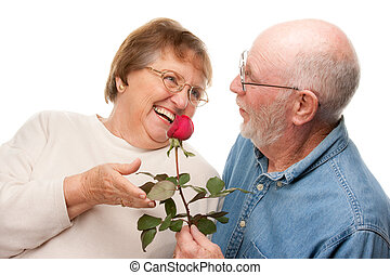 Happy Senior Couple with Red Rose