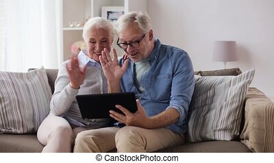 happy senior couple with tablet pc at home - communication...