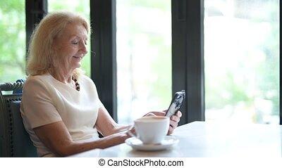 Happy Senior Elderly Woman Using Mobile Phone