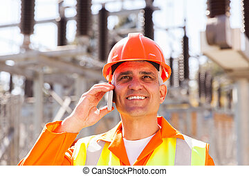 senior electrical engineer talking on cell phone