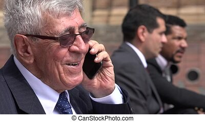 Happy Senior Executive Talking On Cell Phone