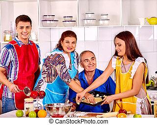 Happy senior family cooking at kitchen. - Happy senior...