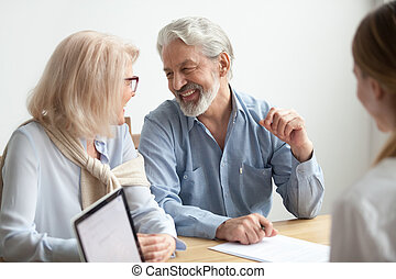 Happy senior family talking smiling at meeting with financial ad