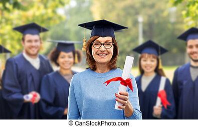 happy senior graduate student woman with diploma