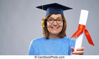 happy senior graduate student woman with diploma -...