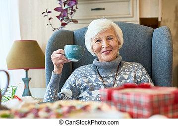 Happy Senior Lady Enjoying Christmas Dinner