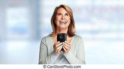 happy senior lady with smartphone