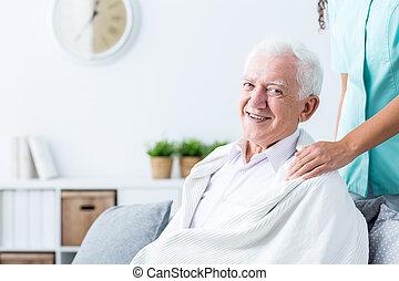 Happy senior man at nursing home