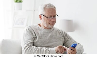 happy senior man calling on smartphone at home 97 -...