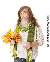 Happy Senior man holding maple leaves over white