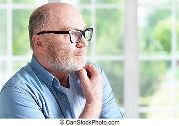 Senior man in glasses