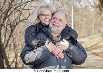 Happy Senior Man Mature Woman Piggyback Outdoor