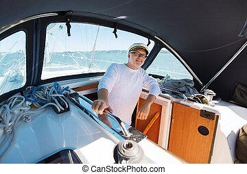 happy senior man on boat or yacht sailing in sea - sailing,...