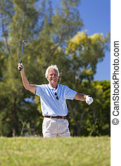 Happy Senior Man Playing Golf