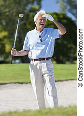 Happy Senior Man Playing Golf In Bunker