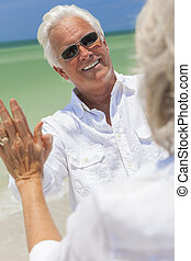 Happy Senior Man Woman Couple Dancing on Beach
