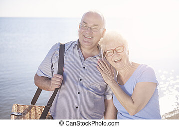 Happy senior marriage going on a picnic